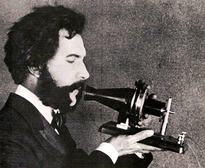 Alexander Graham Bell with first telephone